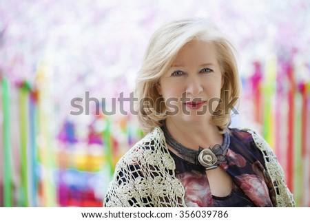 Close up facial portrait of a beautiful senior woman - stock photo
