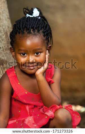 Close up facial portrait of cute african girl outdoors. - stock photo