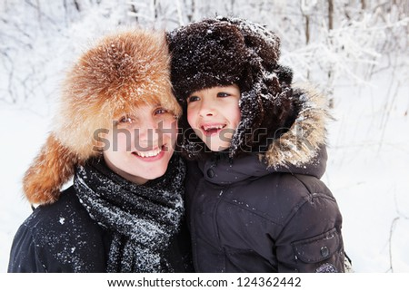 Close-up family portrait of mother and son - stock photo