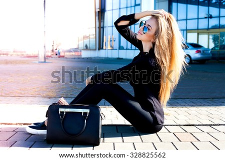 Close-up fashion portrait of glamour sensual young stylish lady wear amazing black teen outfit,basic clothes,black leather bag,sweater and leather bag.Cold season.Warm clothes,reflection sunglasses