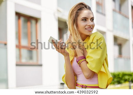 Close-up Fashion woman portrait of young pretty trendy girl posing at the city in Europe,summer street fashion