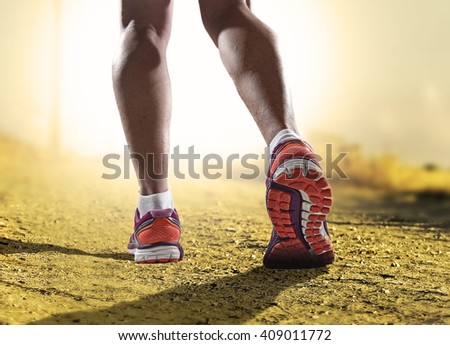 close up feet with running shoes and female strong athletic legs of sport woman jogging in fitness training workout on off road trail track design in advertising poster style sunset extreme - stock photo