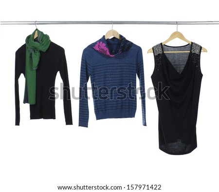 Close up female three clothes with scarf a hanger on hangers - stock photo