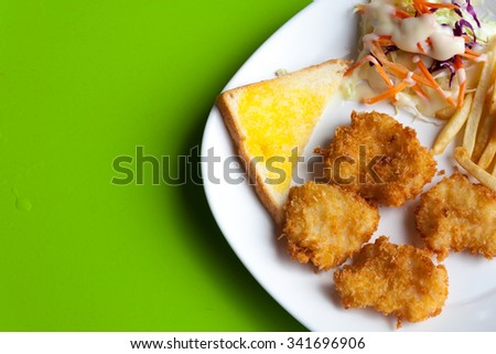 close up fish steak on green background - stock photo