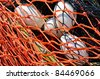 Close-up fishing net with floats on the background. - stock photo