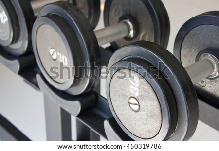 Close Up Fitness Exercise Equipment Dumbbell Weights. - stock photo