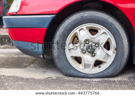 Close up Flat tire on the road waiting for repair,mistake,emerging