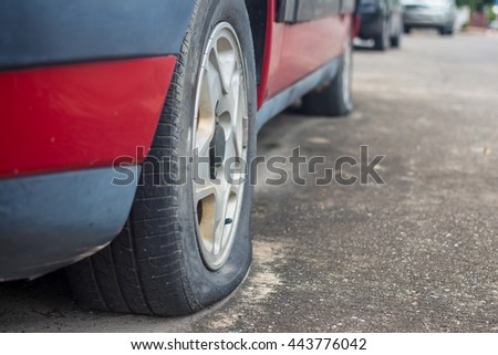Close up Flat tire on the road waiting for repair,mistake,emerging - stock photo
