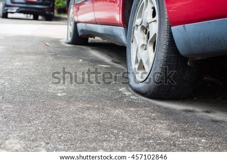 Close up Flat tire on the road waiting for repair, mistake, emerging - stock photo