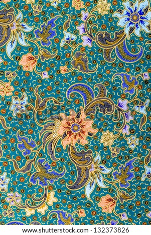 Close up flower pattern background on batik fabric - stock photo