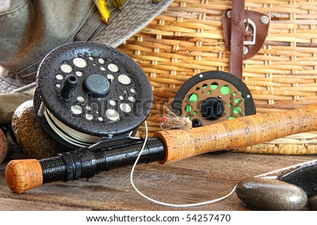 Close-up fly fishing rod with equipment - stock photo