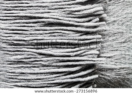 Close up fo the tassels of a wool scarf - stock photo