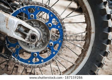 Close up fragment of sport motocross bike wheel - stock photo
