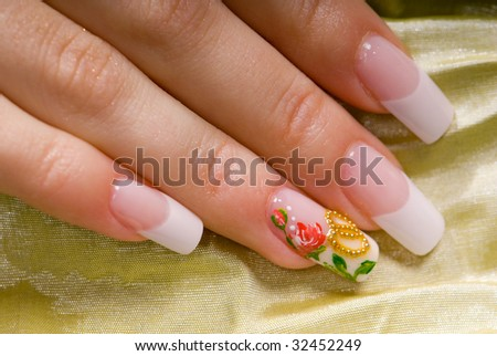 close-up French manicure for a wedding    gold fabric