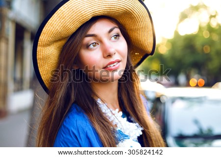 Close up fresh beauty portrait of cute amazing smiling girl, natural glow make up, floral dress summer vintage hat, street evening sunlight. - stock photo