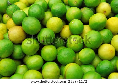 Close up fresh juicy limes on pile - stock photo