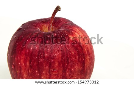 close up fresh red apple with drops on white background - stock photo
