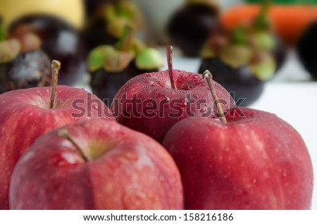 close up fresh red apples with drops - stock photo