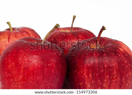 close up fresh red apples with drops on white background - stock photo