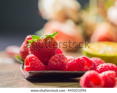 Close up fresh red strawberry put on the table.Ripe red strawberries is delicious.Sweet red berry Spread on the table Raspberries appetizing,selective focus on red strawberry. - stock photo