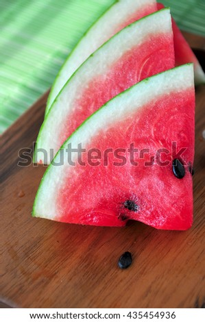Close up fresh watermelon on wooden board - stock photo