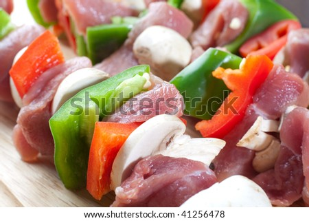 Close up freshly made meat sticks with veggies and pork meat