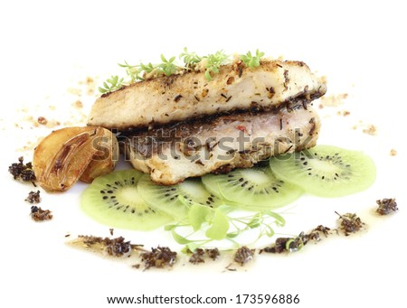close up fried carp fillet served with kiwi - stock photo
