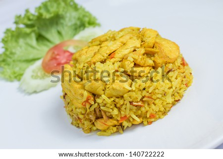 close up fried rice with yellow ginger with chicken, Thai food on white dish - stock photo