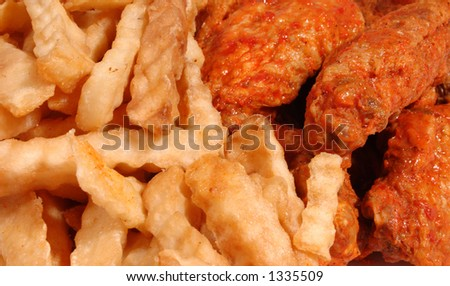 Close up fries and chicken wings - stock photo
