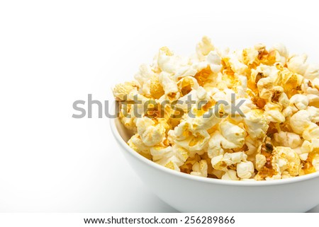 close-up from a shell of popcorn on white - stock photo
