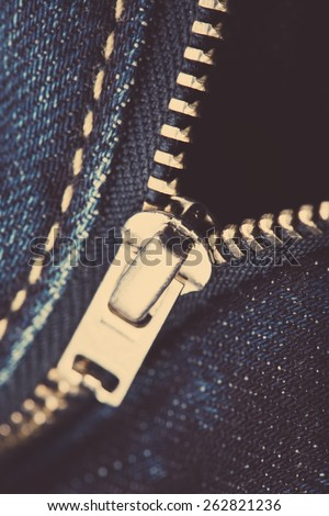 Close-up from blue jeans with zipper - stock photo