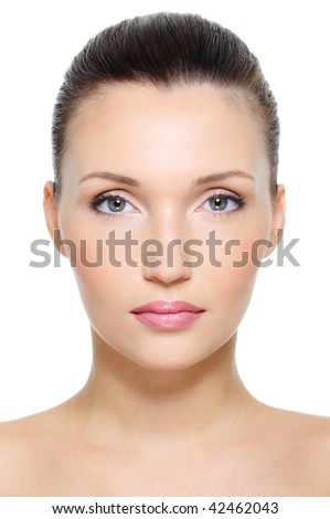 Close-up front view portrait of a beauty young female face over white background - stock photo