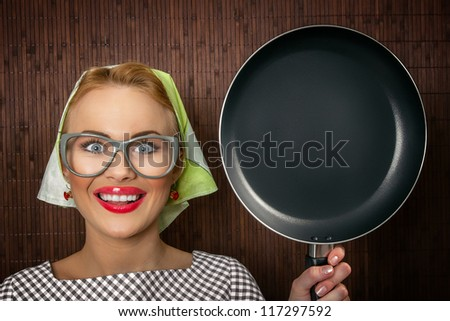 Close-up funny woman cook with pan - vintage concept - stock photo