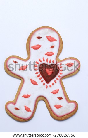 close-up ginger biscuits in the shape of hearts and men on a white background - stock photo