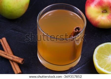 Close up Glass of Cider, Apples and Lemon, Served on Gray Stone Texture Background - stock photo