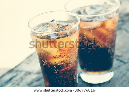 Close-up glass of cola with ice cubes. - stock photo