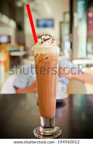 close-up glass with iced coffee blended with cream
