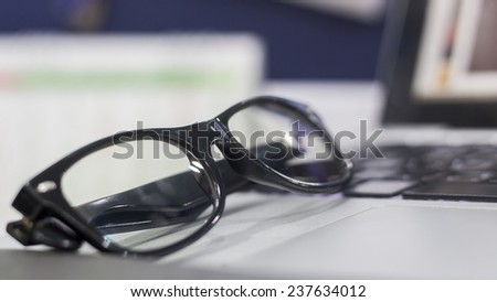 close-up glasses on laptop, office life