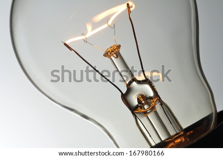 Close up glowing light bulb - stock photo