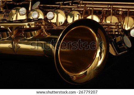 close up gold alto saxophone on black background