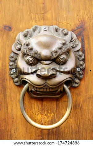 Close up Golden Chinese Old Door in China Temple - stock photo