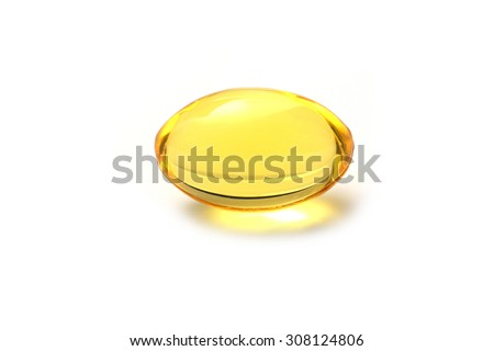 Close up golden color oil supplements in soft gel capsule, healthy product concept - stock photo