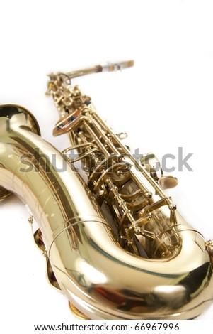 close-up golden saxophone on white background - stock photo