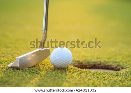 Close up golf ball on lip of cup  in course