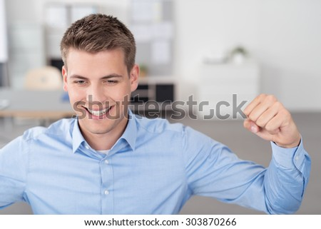 Close up Good Looking Young Businessman Raising his Arms for Success with Happy Facial Expressions. - stock photo