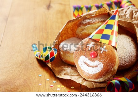 Close up Gourmet Carnival Powdered Sugar Raised Donuts on Paper, Placed on Wooden Table. - stock photo