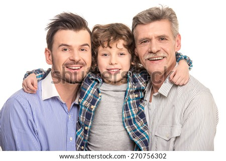 Close-up. Grandfather, father and son smiling and looking at camera, isolated a white background. - stock photo