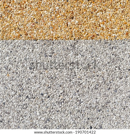 Close up gray and yellow color rough gravel floor - stock photo