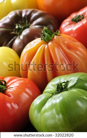 Close up group of multi colored heirloom tomatoes - stock photo