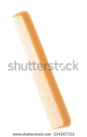 Close up hair comb isolated on white background - stock photo